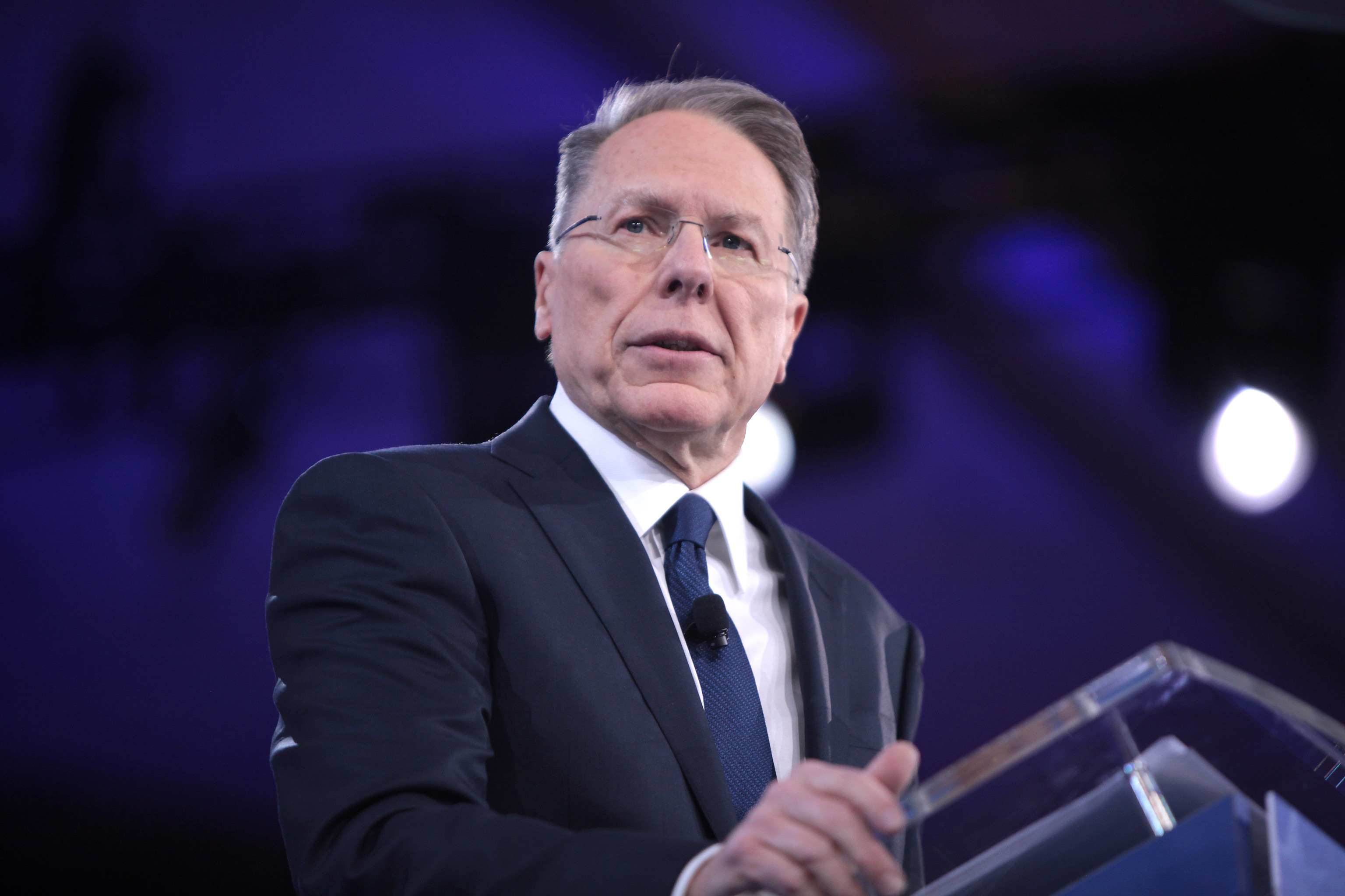 Wayne LaPierre stands at the lectern and looks off-camera during his remarks.